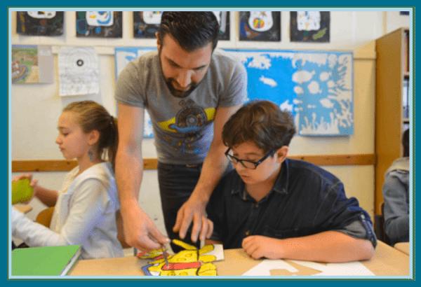 Ali Görmez giving art lesson at school